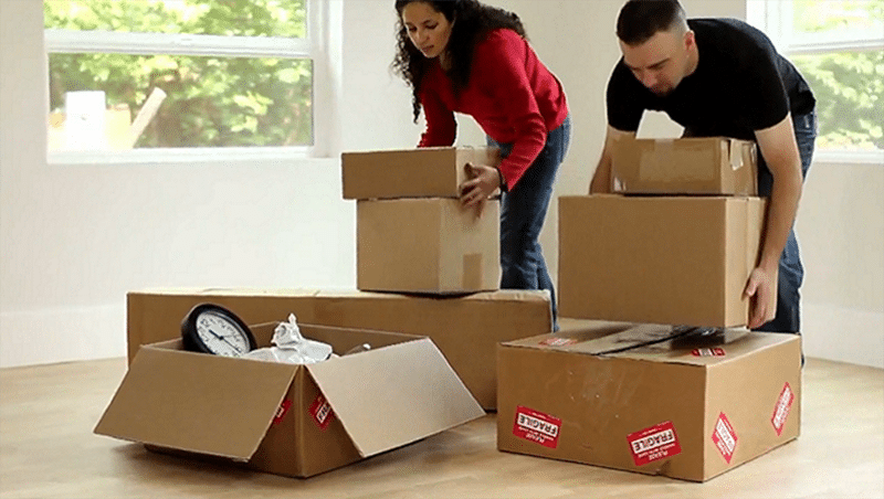 Increased voucher payment standards in high-cost areas (couple stacking moving boxes)